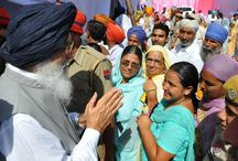 CM at Mega Health Camp at village Badal / Mr Parkash Singh Badal presenting a certificate of appreciation to a doctor who had rendered his services for the heath camp.