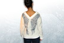 Fashion lable kwolf_f / about cool T-Shirts with animals in all-over-print, wing and feather prints, scarfs, sweatshirts and tunics.