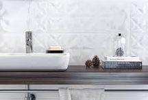 anna bathroom/kitchen concept 3 / Neutral, modern and elegant style with white texture tiles on accent walls. Kitchen: White texture tiles under hanging cabinets. Bathroom: White (White Magic white glossy) or dark grey floor tiles, white wall tiles (White Magic white glossy), white texture accent tiles (White Magic inserto flower)   - bathtub/shower walls.