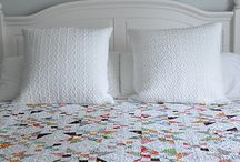 Scrap and Star quilts with secondary patterns