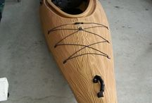 Driftwood / Single sit-in touring kayak with wood-grain finish.
