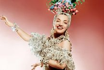 Carmen Miranda / I see Carmen Miranda as the Queen of 'More is More' and as a master in over-accessorizing.   Loving all about it.   The colors, the extreme and bold color-clashes. The happy, sunny looks.