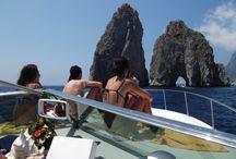 sailing around Faraglioni Rocks with