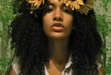 MENATI /  *a prideful black woman* 2-3 looks, flowers in hair and head wrap, printed backgrounds, bold eyeliner, mascara, simple foundation, light lip gloss / by Aliyah Curry