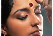 The Bengali Bride / Chandan, bindi and aalta - makes the bengali bride divine.  You will find tp makeup artists at ShaadiSimplified.com for such stunning looks.
