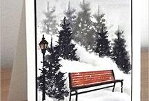 Winterscene / Pine trees & park bench in snow scene