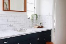 bathroom black and white with teak