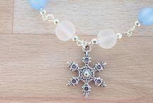 Bracelets / Handmade bracelet with Swarovski Crystal Pearls, Glass Pearls, Seashell Pearls and few metal charm bracelets.