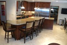 Westerville Kitchen Remodel / A kitchen remodel with an open concept kitchen and living space. This remodel showcases Holiday cabinets, stained cabinets, granite countertops, stainless steel appliances and an island with a sink and seating!