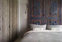 Headboard Alternatives / Take the adventurous route with twigs or splurge on a high-end rug. All of these unusual headboards show creativity and catch the eye
