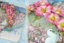 Flowering Dogwood Collection / Immerse yourself in this newest springtime assembling of designer papers, cling stamps and coordinating dies steeped with beautiful meanings and symbolism perfect for the Easter Season. Soft and pastel in coloring, this newest paper collection reveals beautiful springtime shades of pinks, peaches, and greens. Bountiful dogwood blossom filled branches, peaceful white doves and hillside chapels are just a few of the beautiful illustrations found within the cling stamp sets!
