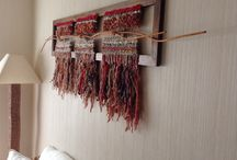 Woven wallhangings on display