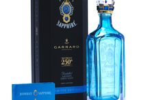Bombay Sapphire Limited Edition 250th Anniversary   Packaging by MW Luxury Packaging / Packaging developed & manufactured by MW Luxury Packaging. A luxury display box for a limited edition anniversary launch. This pack was produced in collaboration with Stephen Webster and Garrard. The rigid board structure is covered in a soft touch paper with foils and spot varnishes applied. The EVA fitment holds the handmade decanter securely inside the bespoke acrylic plinth and a booklet is kept in a recess in the base. Packaging Developed and Manufactured by MW Luxury Packaging