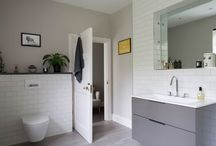 A Bright White Ensuite / A tired and gloomy bathroom gets a thoroughly modern make-over, modern metro tiles and a wood-effect floor feature in this contemporary bathroom.