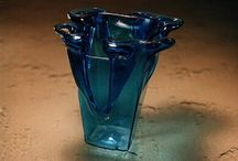 Usable glass - flowertops / The next example of our branch is little usable glass form design. Mamy kinds of colored and transparent glass are seal by heating. This way we can make free mind, unique products. Glass can be use like a ashtrays, sugar bowls, candlesticks, dishes and others.