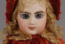Dresses red- ecru, antique dolls