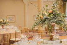 Rustic Romance / Set in the Treasury Hotel, this beautifully crafted rustic theme, enveloped all elements of romance, from florals right down to the customised stationery.  Hues of gold and sage, mixed with cream, captured this alluring and majestic theme. Illuminated by gold mercury tealight and complimented with gold cutlery, this setting was sophisticated whilst remaining feminine and delicate.  Youtube: www.youtube.com/watch?v=NNk6xEz3_Sk  Enchanted Empire