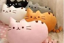 Cat pillows and stuffed animals