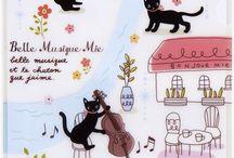 gatitos tocando violines