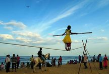 Balanced life on Marina Beach, Chennai. / Marina Beach is a natural urban beach in the city of Chennai, India, along the Bay of Bengal, part of the Indian Ocean.During summer months, about 15,000 to 20,000 people visit the beach daily.