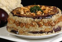 Arabic foods and Deserts / آكلات عربية            Hummus Baba Ganoush, grape leafed, and other foods