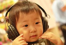 Music & Children / Music enhances creativity, and imagination and has been shown to help with language development, reasoning and stress reduction. Through singing and dancing, children begin to learn about rhythm and beats, enhancing their motor skills and bodily coordination.