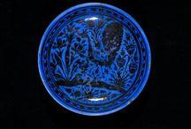 blue slip, overglaze painted in lustre.