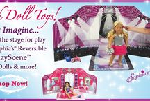 """Setting the stage for play with Sophia's® 18"""" dolls for American girls / This unique backdrop features two different play themes: Fashion Show with dazzling lights, curtains and a runway, or My Bedroom with a spectacular display of color, clothing and furniture. There is also a reversible floor for each of the scenes. Set the stage for your American doll with this new product by Sophia's®."""