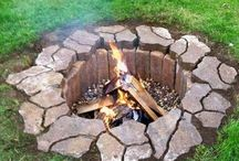 Fire Pit Ideas / A small fire pit as a fantastic addition to any outdoor space. It serves as a place to gather and spend time with family and friends. It's a place to cook. It's a place to stay warm. Fire pits help to extend the months that you can spend enjoying your yard. Here are some of our favorite ideas for fire pits that you can add to your home. Many of them are low cost and DIY!