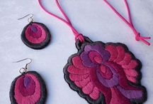 Hungarian Embroidery / Hand-embroidered pendant with a pair of earrings, with Hungarian folk motif. The whole surface is embroidered. http://www.folk-art-hungary.com/embroidered-jewels.php