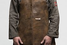 The Rag and Bone Man Leather Workshop Apron / Having destroyed more than a few workshop aprons Paul thought that it was time we made our own that would last.  Our leather workshop apron is made using distressed nappa leather that has a natural full grain. Knicks, burns, scars and marks all tell the story of this product's journey and accentuate its character. This softer leather is also very flexible, perfect for light and medium duty.