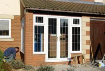 Bishops Cleeve 2001 / White PVCu frames and square Georgian leadwork into a new porch construction.