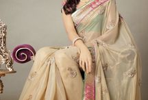 Designer Sarees in online / From the earlier days till today sarees are considered the most beautiful attire that compliments a woman's beauty in the most decent and elegant manner. It is the only versatile attire which can be chosen as party wears as well as formal wears.