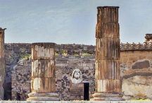 The Temple of Jupiter and behind Mount Vesuvius from Pompeii, Italy #HeathrowGatwickCars.com
