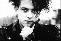 the cure and robert in a chain of flowers