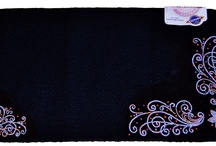 Bling Saddle Blankets / We custom design saddle blankets to meet your need. Genuine glass crystals make up a stunning design that gets you noticed.  www.pamperedcowgirl.com