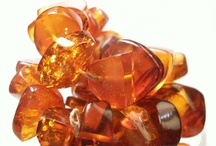 AMBER SECRET / Amber is essentially fossilized tree resin and can vary in colour from yellow to red and sometimes green through to blue but its more familiar colour is a deep honey brown. Sometimes insects or pieces of vegetation are trapped in the resin.  Amber jewellery incorporates a living gemstone that changes and evolves imperceptibly over the years. Amber is believed to ground higher energies into the earth plane, helping to bring about a balance to the mind, body and spirit. Silver Island UK
