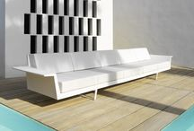 COLLECTION FLAT / The FLAT Collection is made up of various pieces that can be used to form exterior lounge areas, but are also adequate for interior ones, thanks to their neutral shapes that are still full of identity. One of the characteristics of this set is that it looks light, because it rests on the floor on beautifully formed aluminum legs which give the object an appereance of virtually floating.
