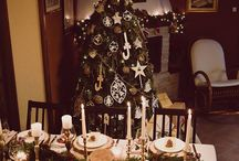 Christmas table / Special Christmas dinner in family - wood decoration style.  My favorite way to dress up a table is with some simple wood slices, greens and plenty of candles. Love the table and the warm glow from the candles. Enjoy Christmas time.