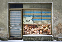 "Closed @2011 / Recently I have been attracted to images of storefronts which provoked a memory of the old doll store that my mother took me to when I played ""doctor"" with my sister's favorite doll. I have filled the windows of my stores with portions of dolls or mannequins because they have no connection to the individual storefronts. As the first store I depicted had a ""Closed"" sign on the door, I have used that word in the names of the montages in the series. All the images have been digitally integrated."