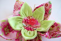 pretty fabric flowers / by Carol Hewitt