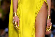 C. Yellow