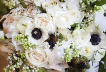 Suzanne / An elegant wintery feel, using whites and off white flowers teemed with sage green and silvery tones and dark inky hues leaning toward black. Botanical elements of berries, succulents and gum add texture against the softer petaled flowers.