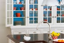kitchen / red, turquoise, with white background and pops of yellow; stainless steel accessories.