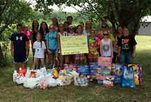Tari's Cornerstone School of Dance / Rikki's Refuge was paid a very special visit by Tari Ott and some of her wonderful dance students from Tari's Cornerstone Studio for Dance in Haslett, Michigan! This fine group of young folks worked hard to collect food for our animals, and also presented Rikki's Refuge with a generous donation! All the critters are so excited and will love the attention! WOW! THANK YOU!
