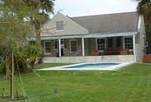 Noordhoek Place: Dec/Jan only / Noordhoek Place is a beautiful 3 bedroom home sleeping 4 to 6 people.  This house has a massive manicured garden - complete with outdoor patio & couches, built-in braai, swimming pool, trampoline, jungle gym & hammocks for summer family fun. Ideal for families!
