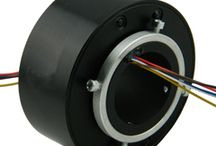 Through Hole Slip Ring / Through hole slip rings are slip ring with through bore, this series iare designed for being installed with flange on a sleeve bracket, also they totally meet with continuous transmission of power and/or signal under 360 degree unrestrained rotations. This kind of slip ring applies the best advanced fiber brush technology and precious metal multi-contacting, low noise, low contact pressure and maintenance free.