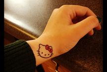 Hello kitty tattoos / by Kitty White
