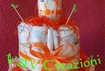 MY DIAPER CAKES - TORTE DI PANNOLINI / Torte di Pannolini un'idea utile per: nascita, battesimo,1°compleanno .A Sestu ed Elmas (CA)3409790012 - vevcreazioni@gmail.com Un'idea originale, economica, soprattutto utile e di grande effetto da regalare ad una neo mamma ed al suo piccolino: la Diaper Cake,ovvero la torta di pannolini!!  Per info e dettagli: 3409790012 - vevcreazioni@gmail.com Ci trovate a Sestu ed Elmas (Cagliari) https://www.facebook.com/VeVCreazioni My creations of:*diaper cakes,*make up cakes and so on!