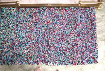 Rag Rugs / Rag rugs traditionally made with old clothing.  It depended on what colours you wore to what colour your rug was.  Some of the patterns could be very intricate.